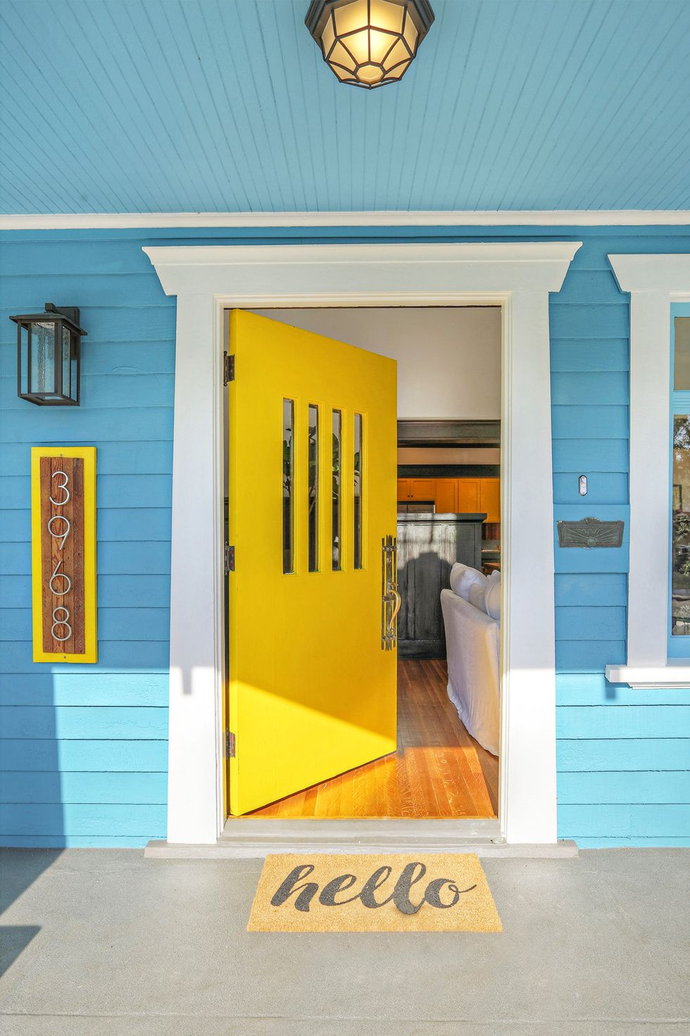 Cabin Fever Projects: Eight of our top 10 is Summer Sun Valspar 3007-2B. Moreover the door is primed with white and the siding is bright blue.