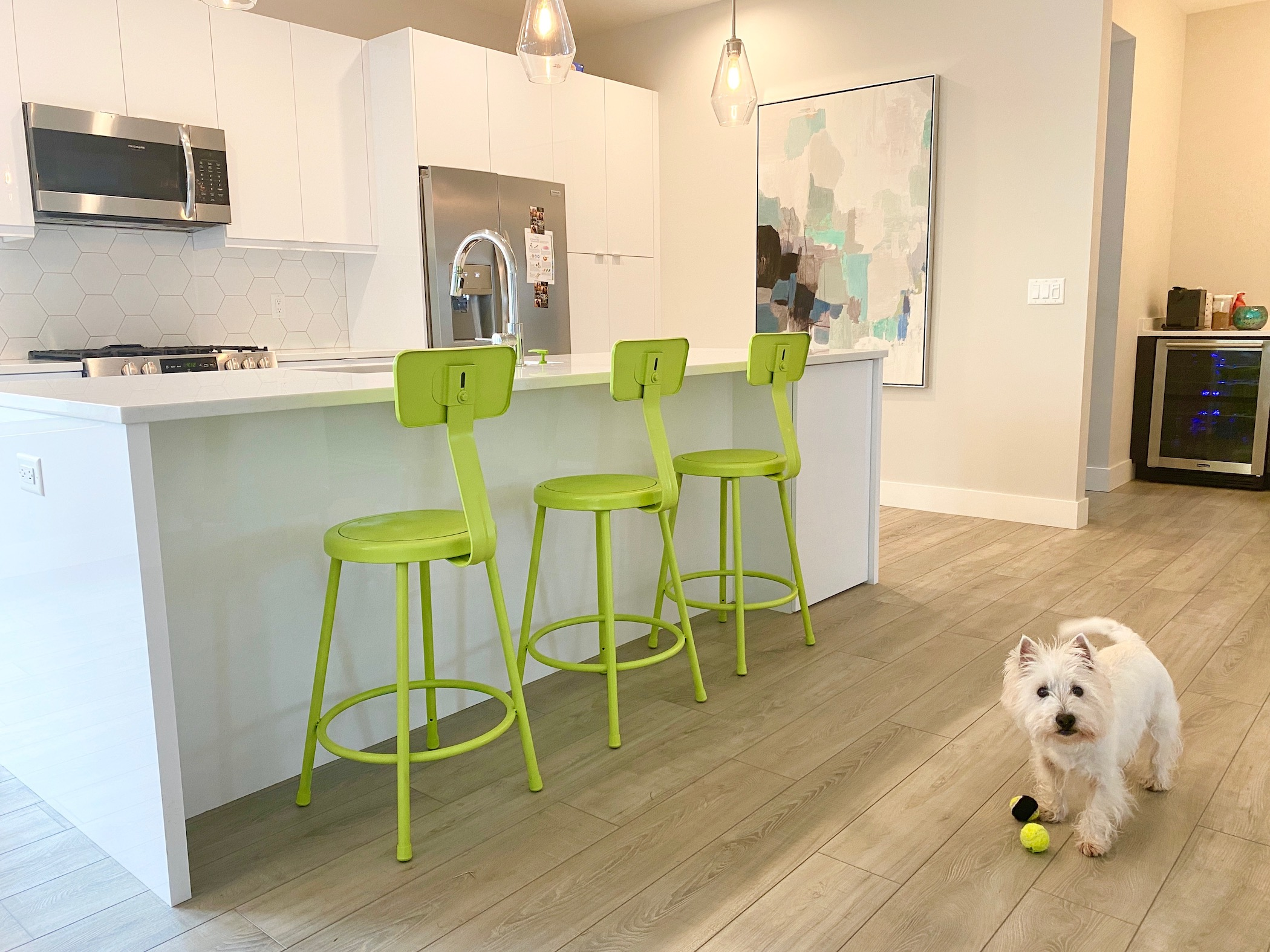 Also, the Chartreuse Color on the Stools makes the room happier. The counter and cabinets are white.