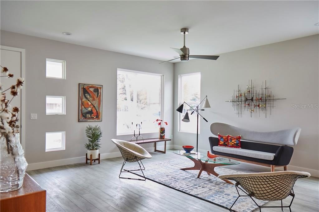 But Light fills this home at 5045 Dartmouth Ave. N. Also the room is decorated with authentic Mid Century Modern decor.