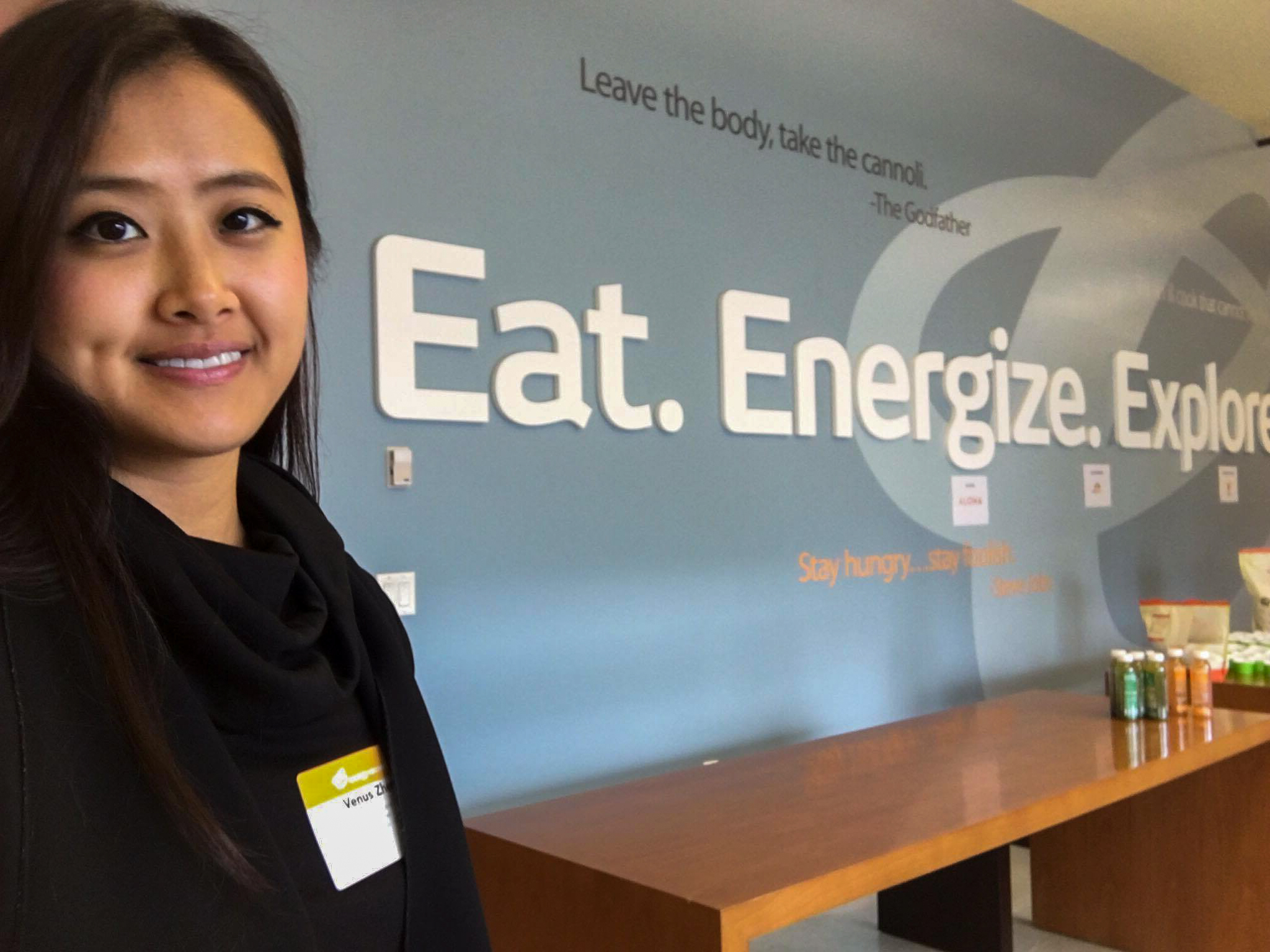 Venus Zheng posing with slogan at Energy Recovery