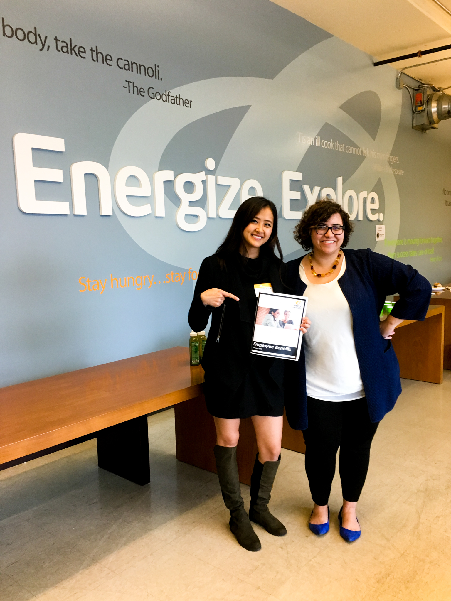Venus Zheng and Rose Nemet posing with slogan at Energy Recovery
