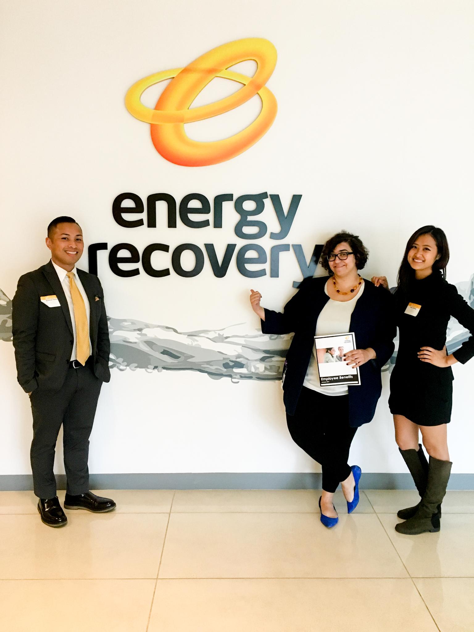 Rommel Yema, Rose Nemet, Venus Zheng posing in front of Energy Recovery logo