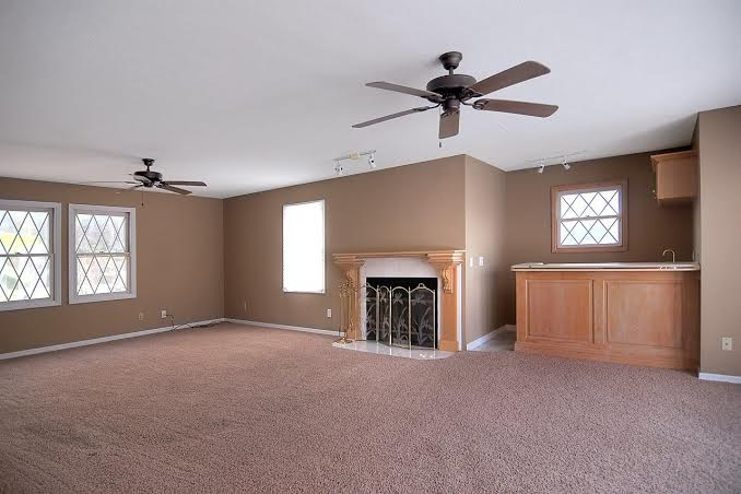 Living room, with fireplace, wet bar, and views of the pool!