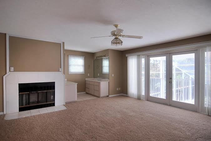 Master bedroom, with balcony, fireplace, and huge custom closet