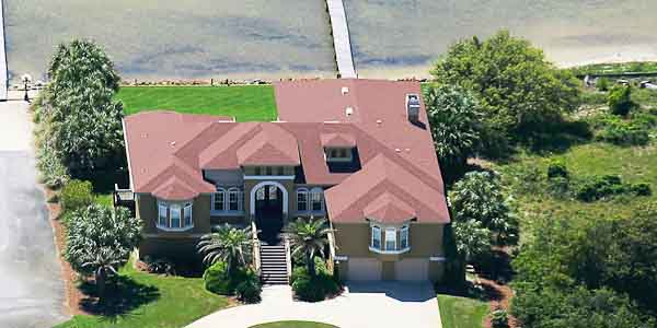 aerial photo of waterfront home
