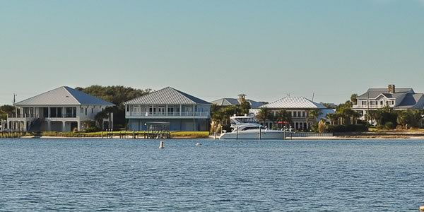 three bayou waterfront homes