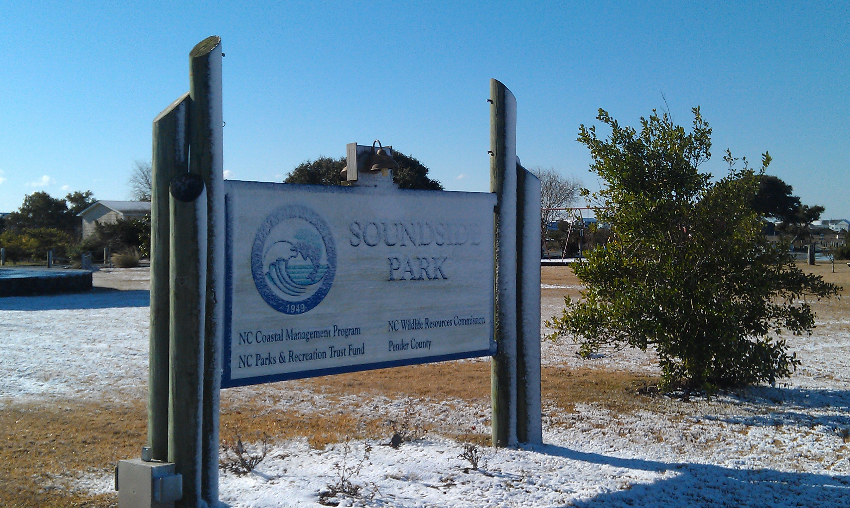 Surf City Welcome Sign With Snow