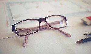 pair of glasses on a white desk