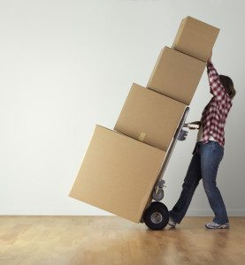 a person moving a stack of boxes