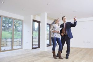 an agent showing a buyer a home