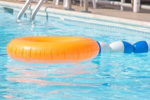 community pool with inflatable innertube