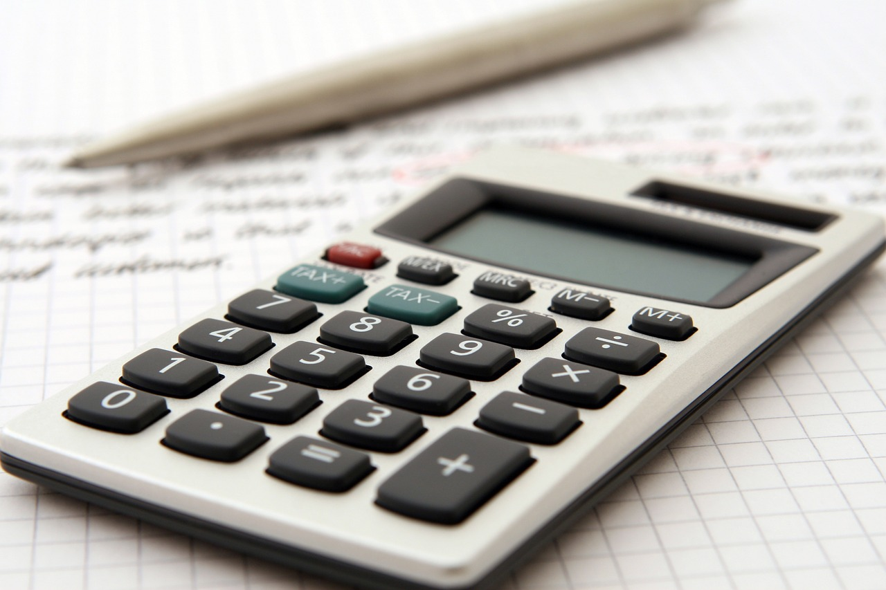 calculator next to accounting sheet