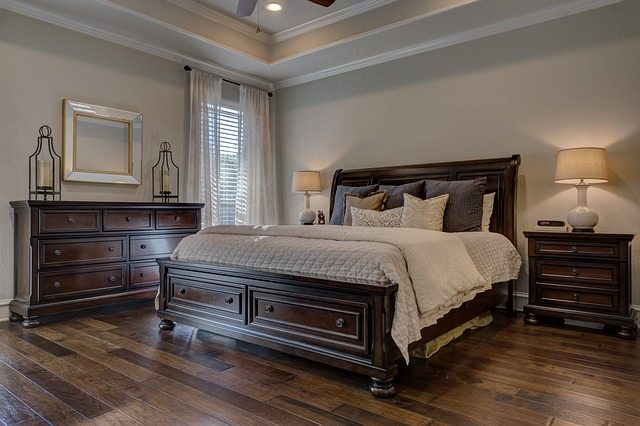 room with wood bed and beige walls