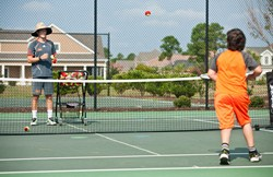 Enjoy tennis on the clay courts of Plantation Lakes