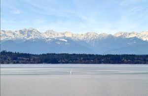 Sound View with sailboat and the Olympics