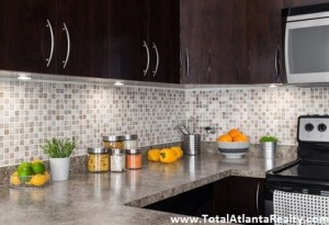 Modern kitchen with cozy lighting, and food ingredients on the counter top.