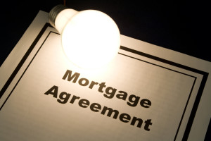 Mortgage Agreement and light bulb