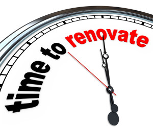 The words Time to Renovate on an ornate white clock, counting down to the moment you will rebuild or take on a reconstruction do it yourself project or as part