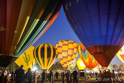 Multiple Balloons lit up at the Santa Paula Balloon Festival