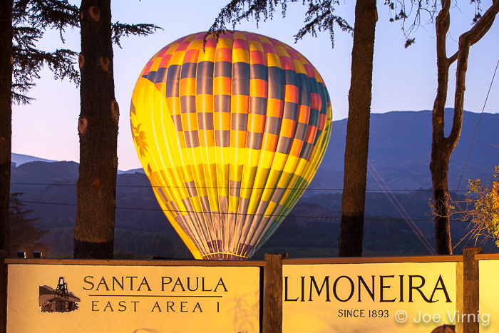 Balloon Glows behind the Limoneira East Area I sign