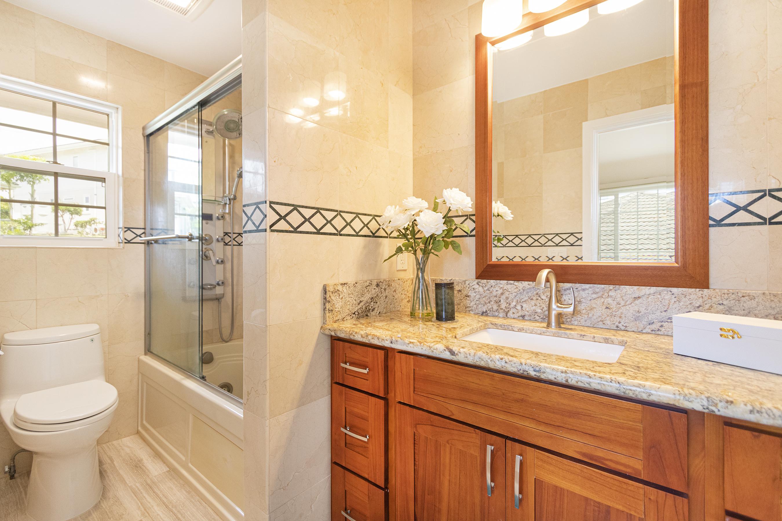 Junior suite bathroom at 122 Kokololio Place