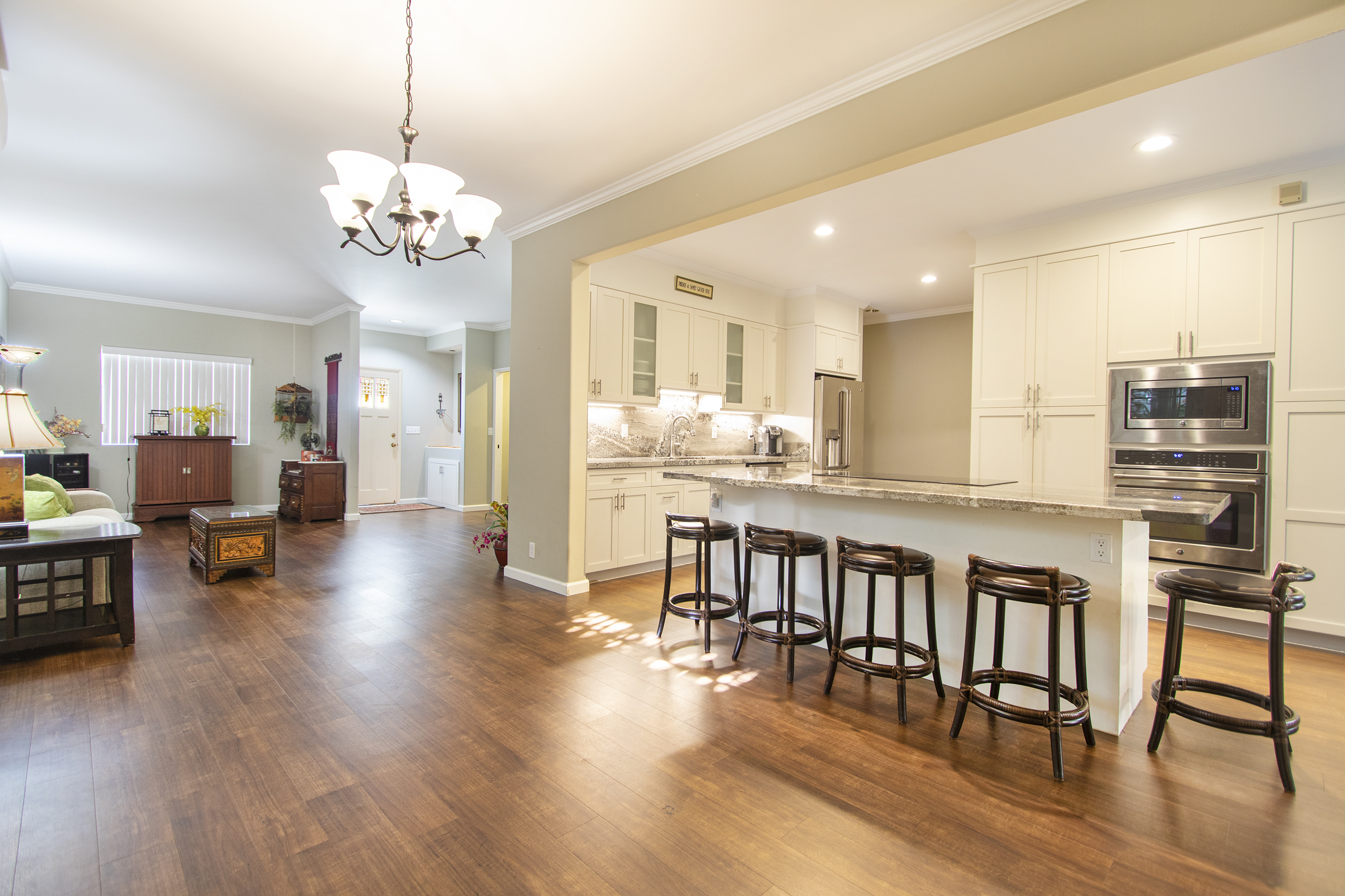 remodeled kitchen with large granite countertop island