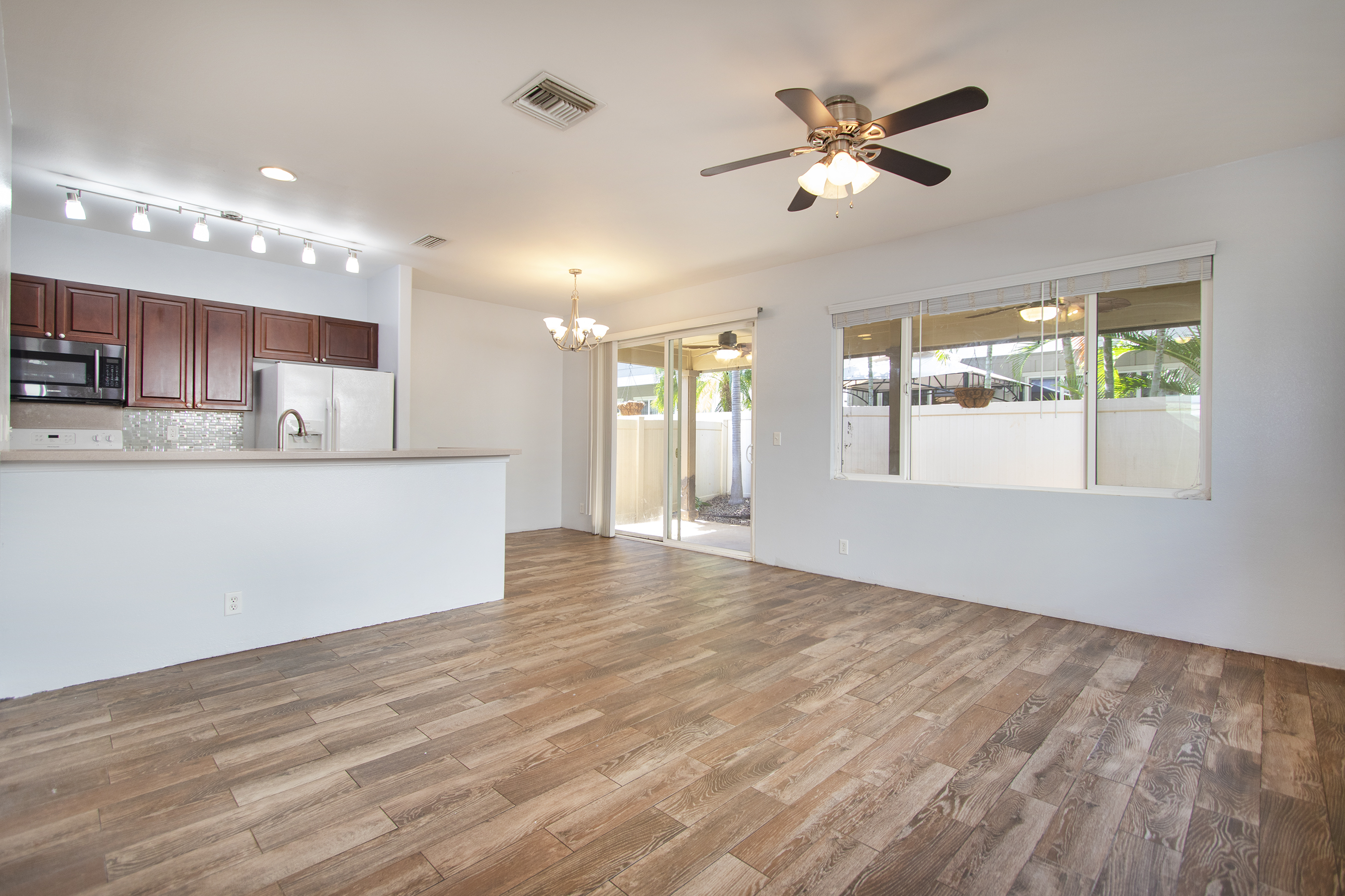 Living room and open kitchen with wood plank porcelain tile flooring