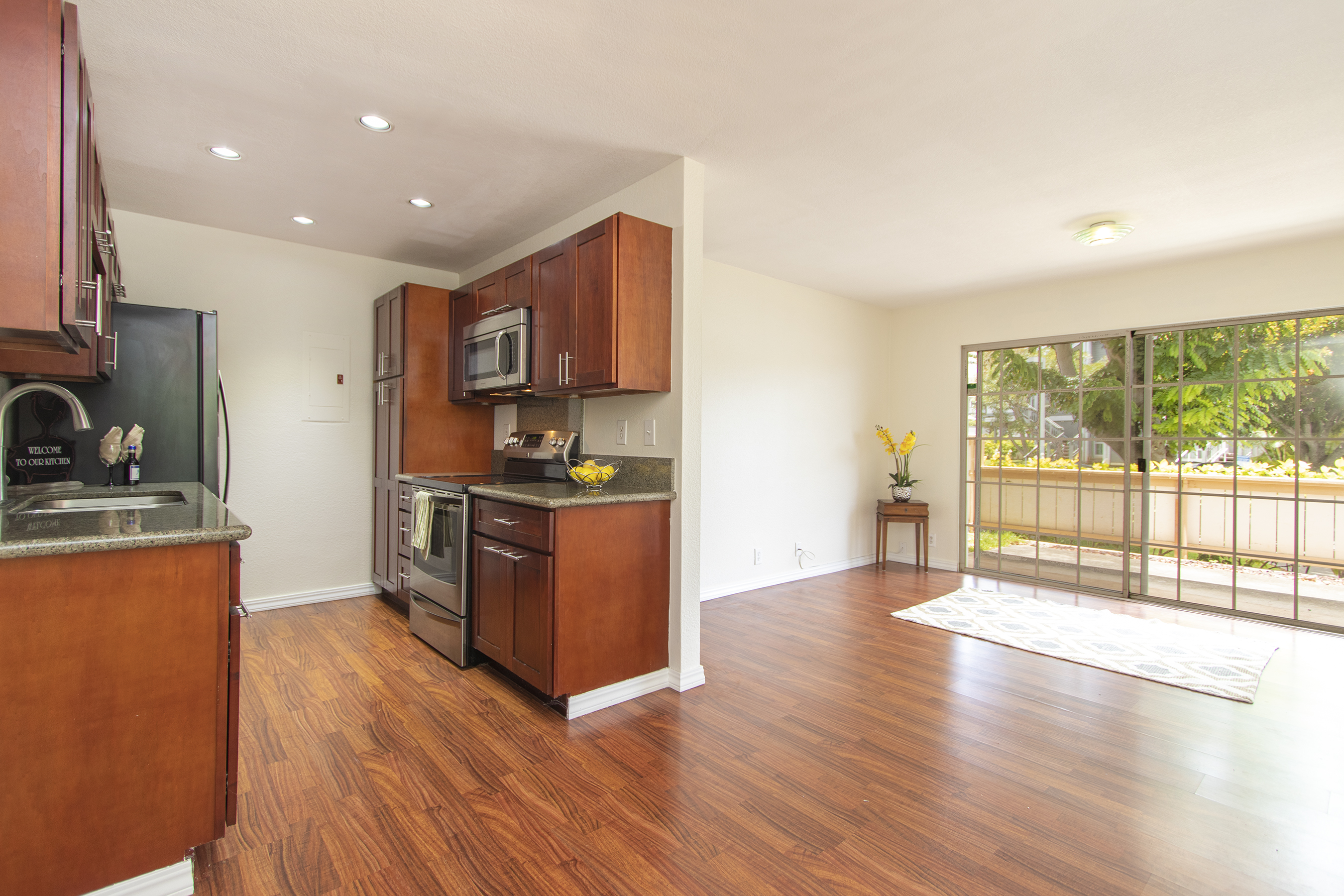 Kitchen and Living Room View at 311 Mananai Place #45a, Honolulu, HI 96818