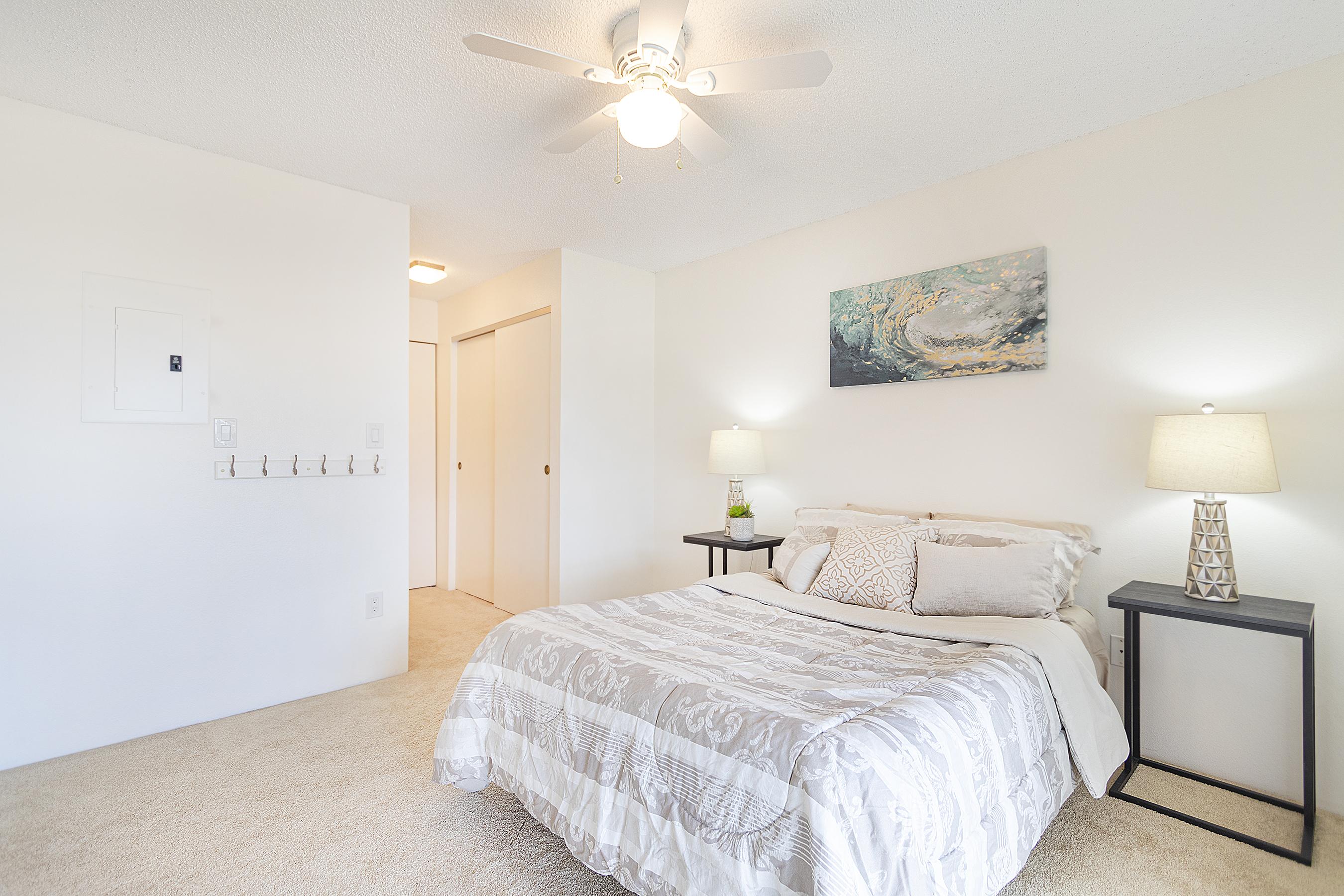 Master bed and view of closet at 94-870 Lumiauau St #Y201