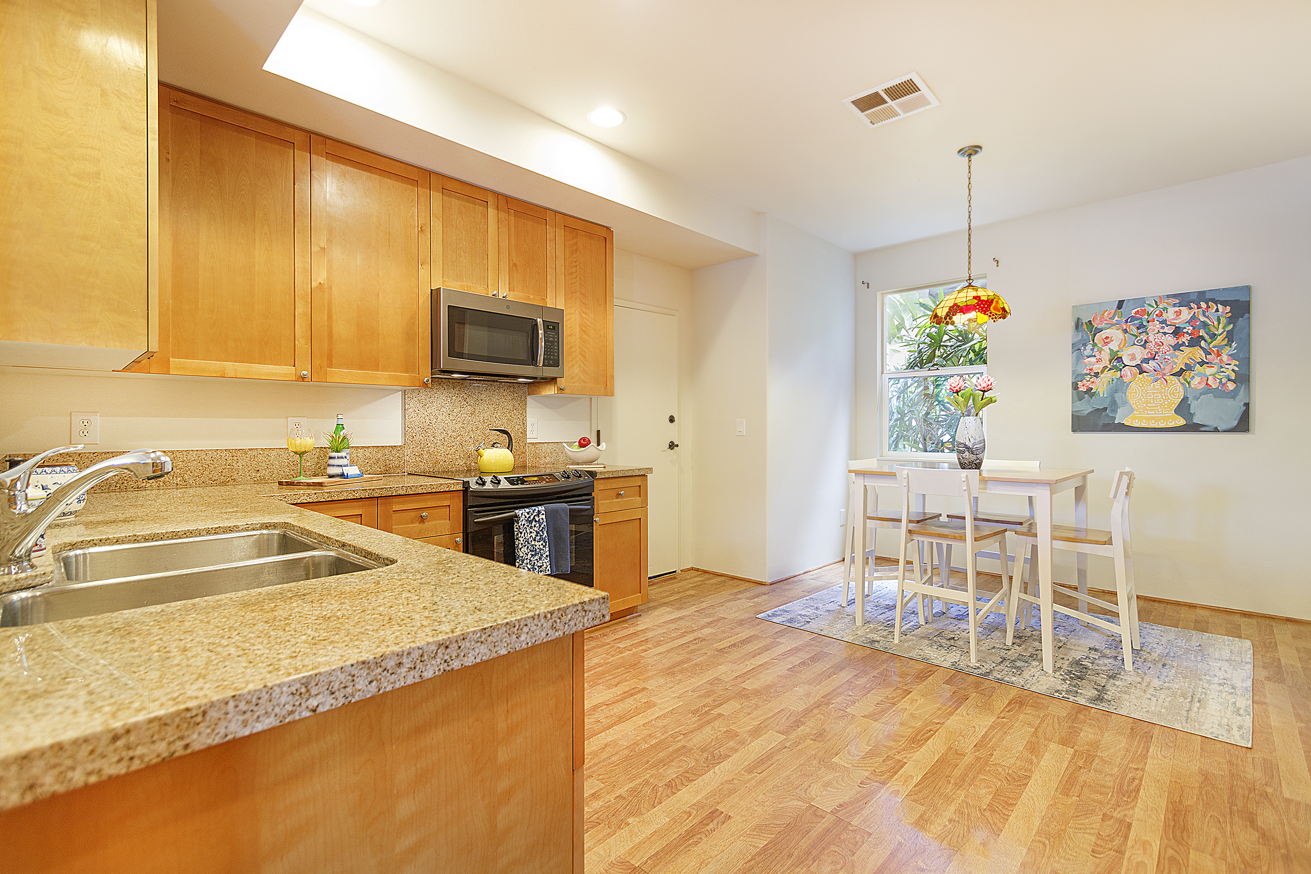 Kitchen and casual dining at 580 Lunalilo Home Road VB2409