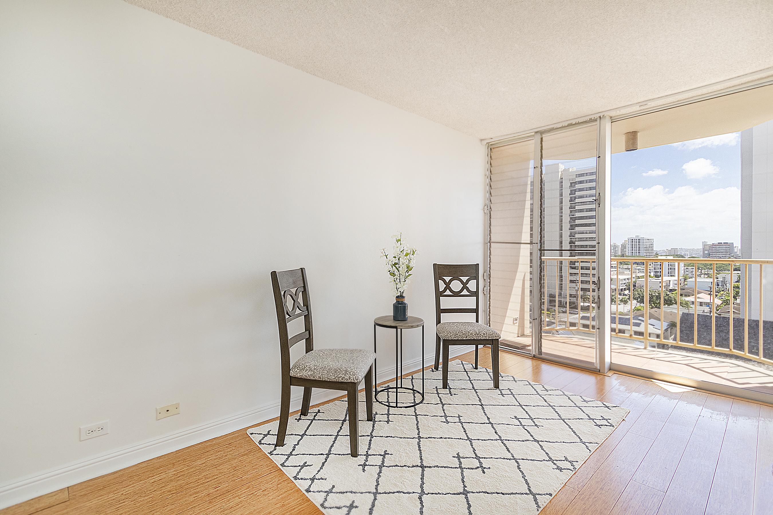 Living room and lanai view at 1535 Pensacola St #711, Honolulu, HI 96822