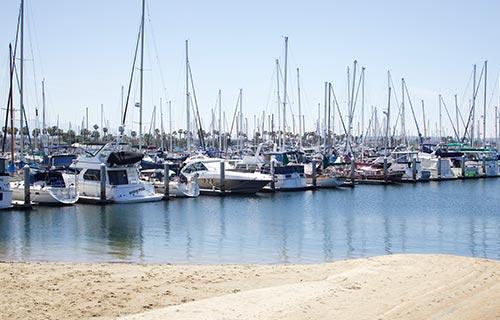 rows of boats at j street marina in chula vista
