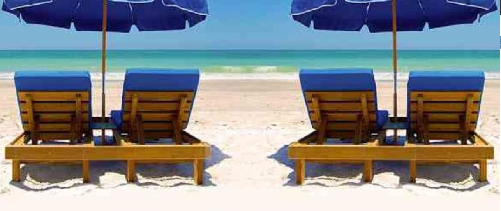Blue Beach chairs with Umbrellas