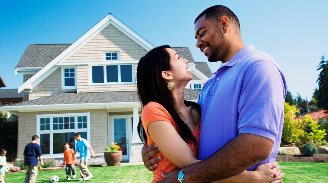 image of a couple in front of a home