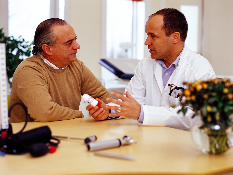 doctors talking to patient