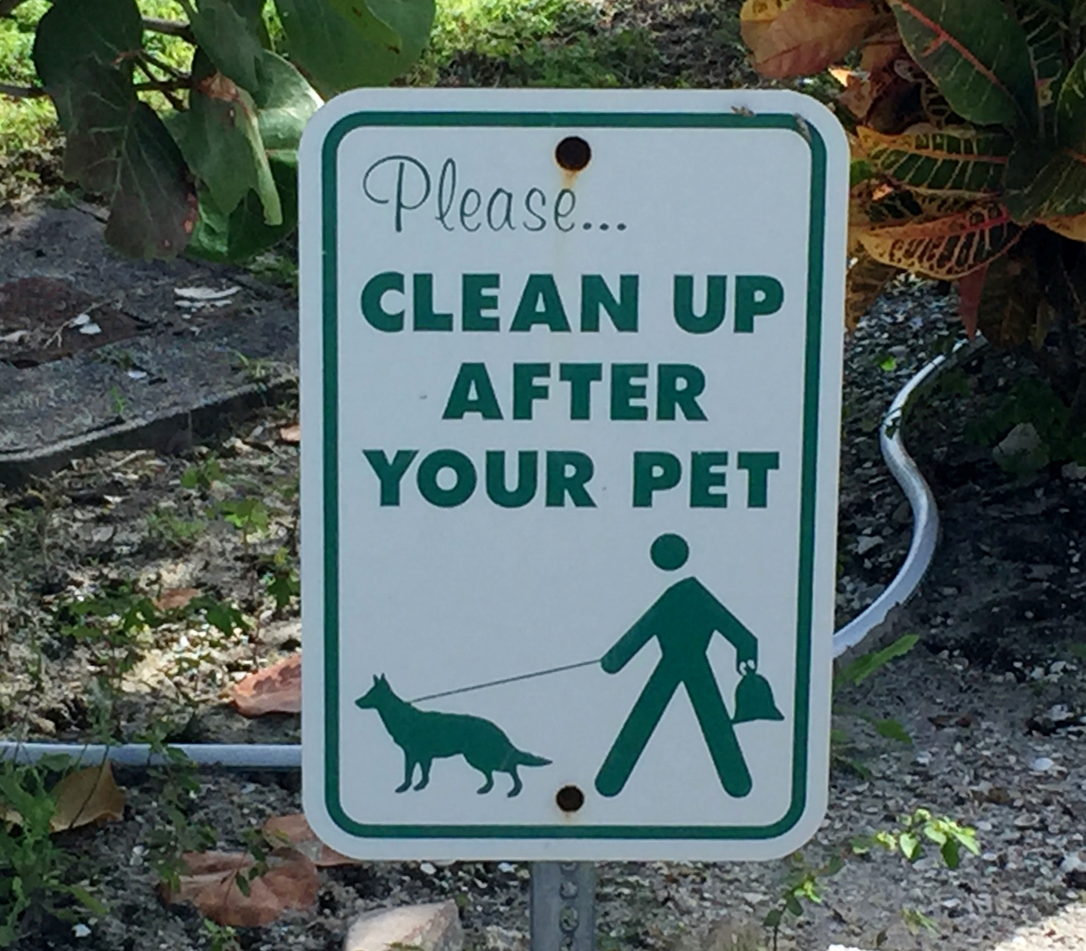 Pet clean up sign