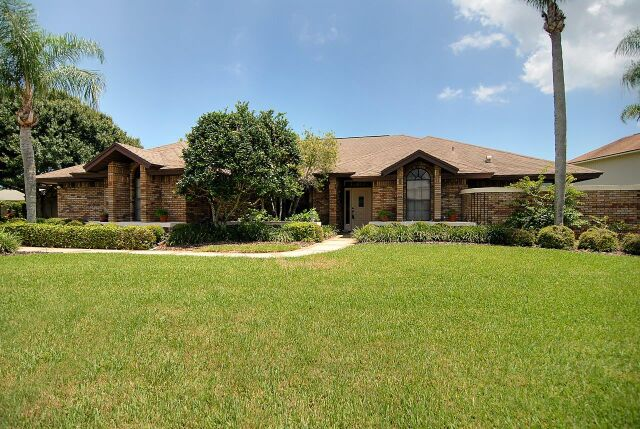 The Coastal Estate Team Just Sold This Lakefront Suntree Home