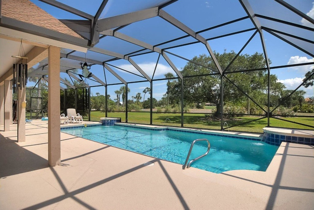 Covered Lanai and Pool with Golf Course Views!