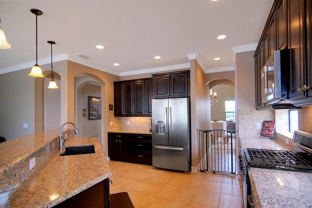 Open kitchen with gas range and stainless steel appliances