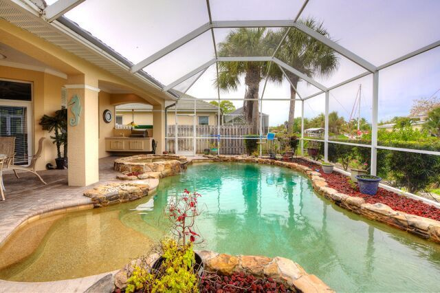 Covered Lanai with Summer Kitchen and Tropical Pool