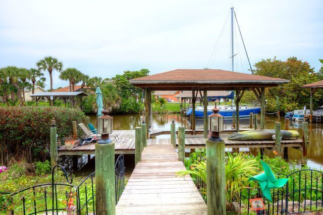 Private Dock with Boat Lift and Seating Area