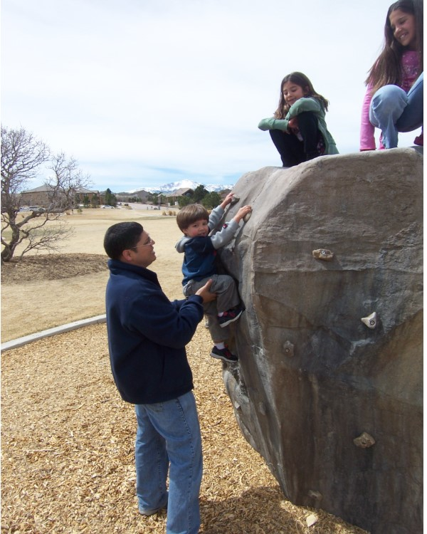 Family enjoying rock climbing at Dr Frank Houck Park in the University Park Subdivision of Colorado Springs