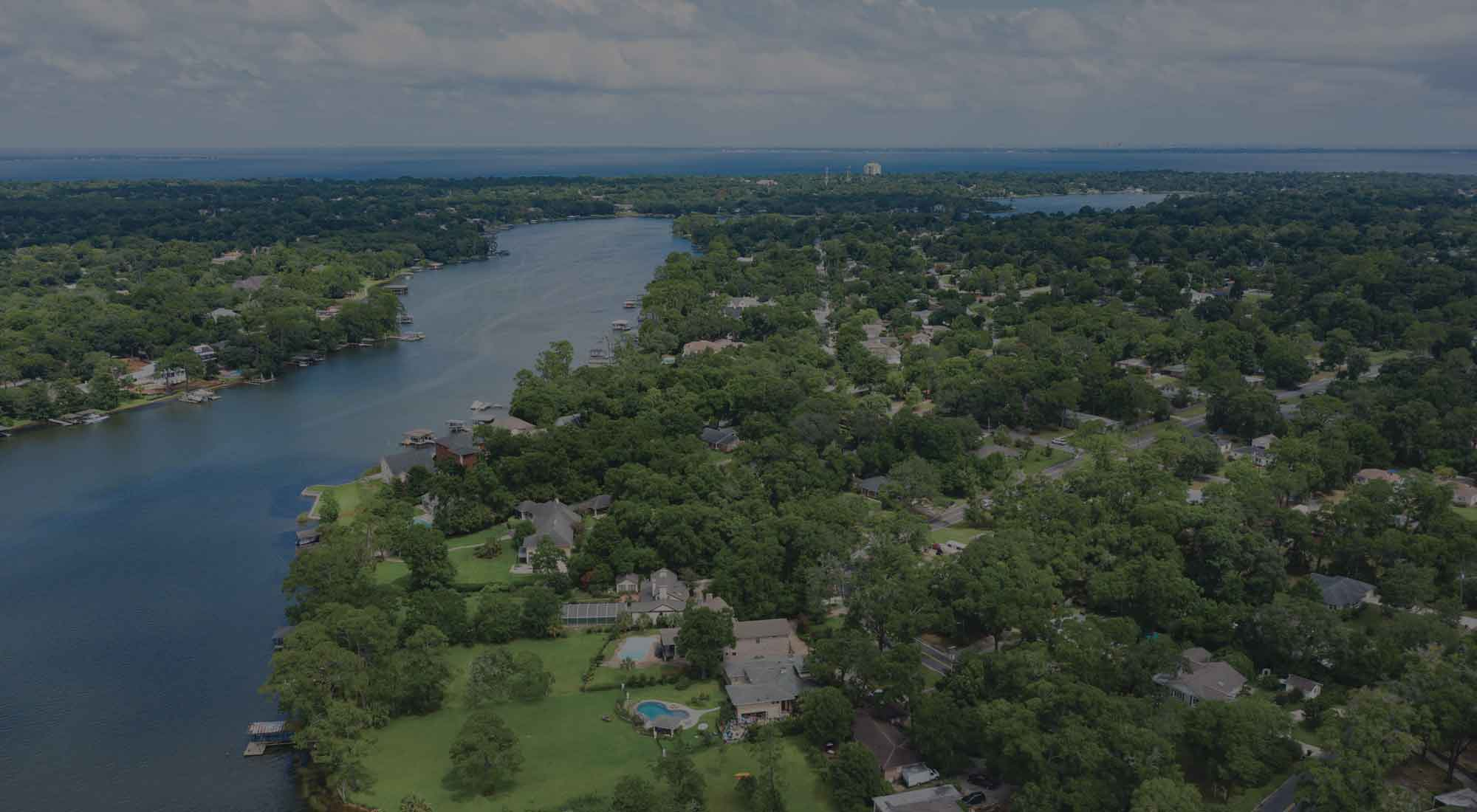 drone view of real estate along Bayou Texar in East Hill