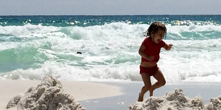Girl playing in the surf at Navarre Beach