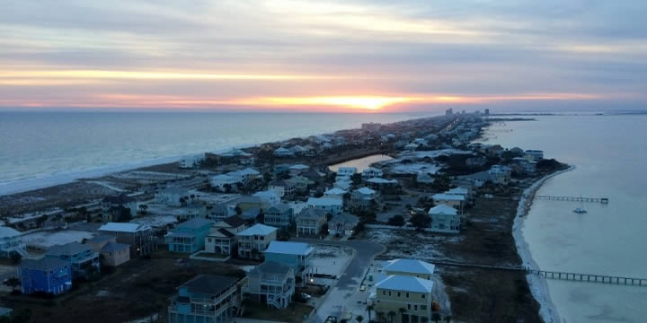 Pensacola Beach houses at sunset