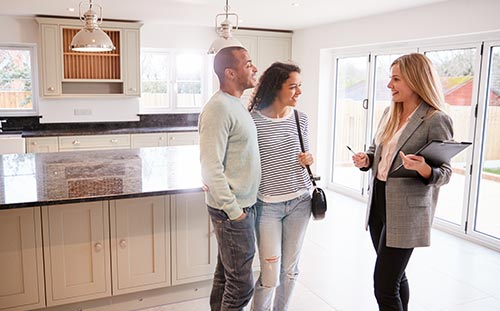 realtor giving house tour to buyers
