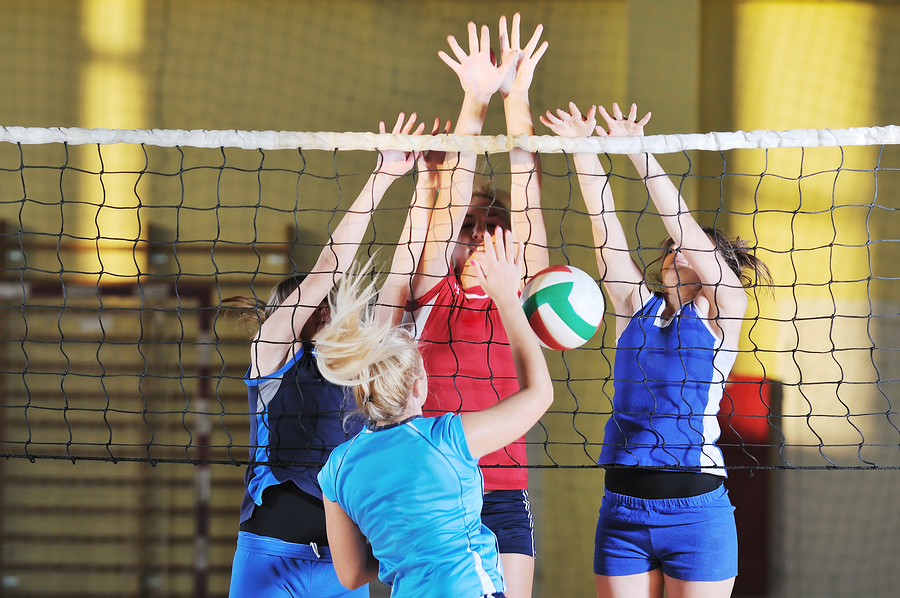 Girls play volleyball on Port St. Lucie real estate.