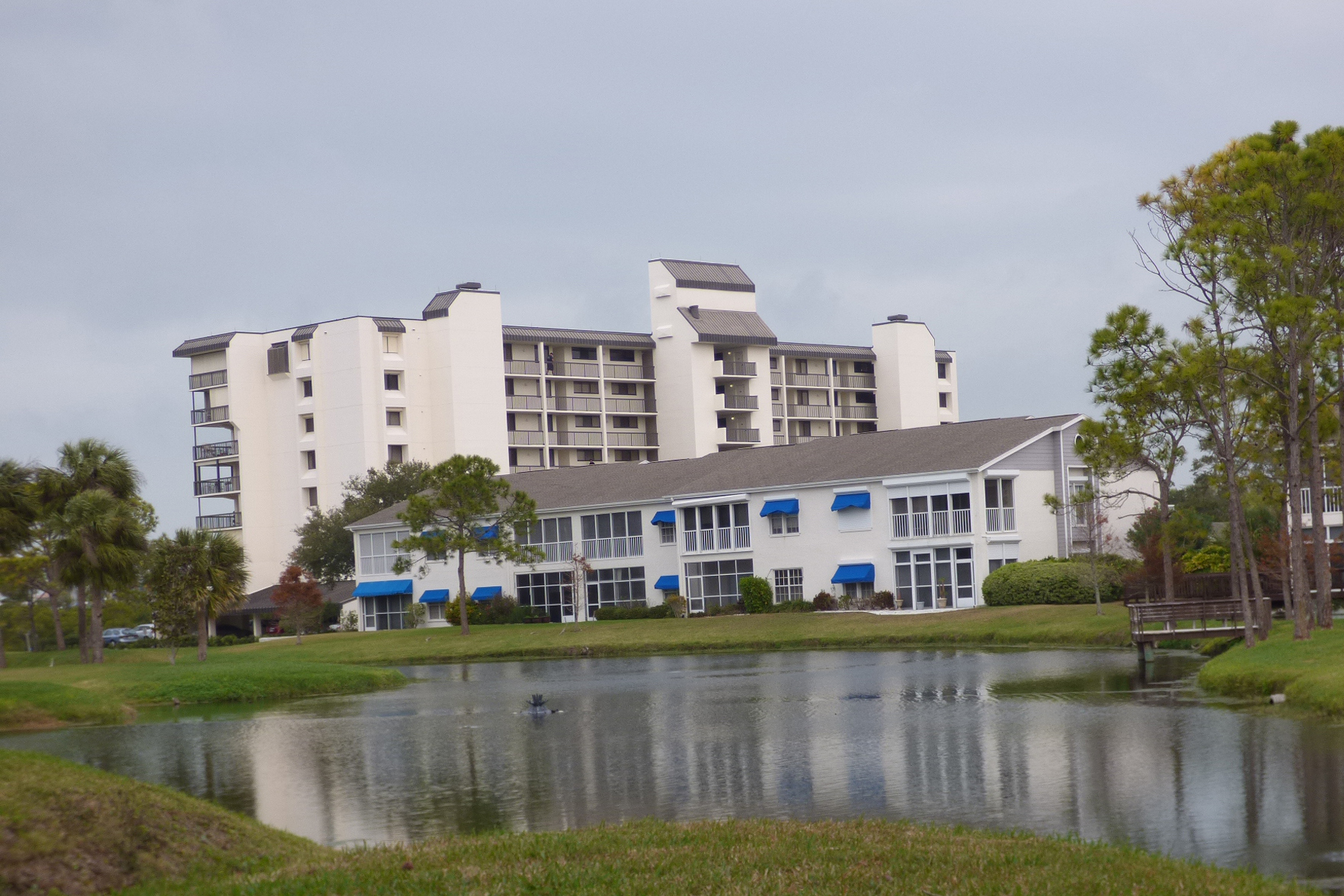 2 mid-rise buildings, pond, villas