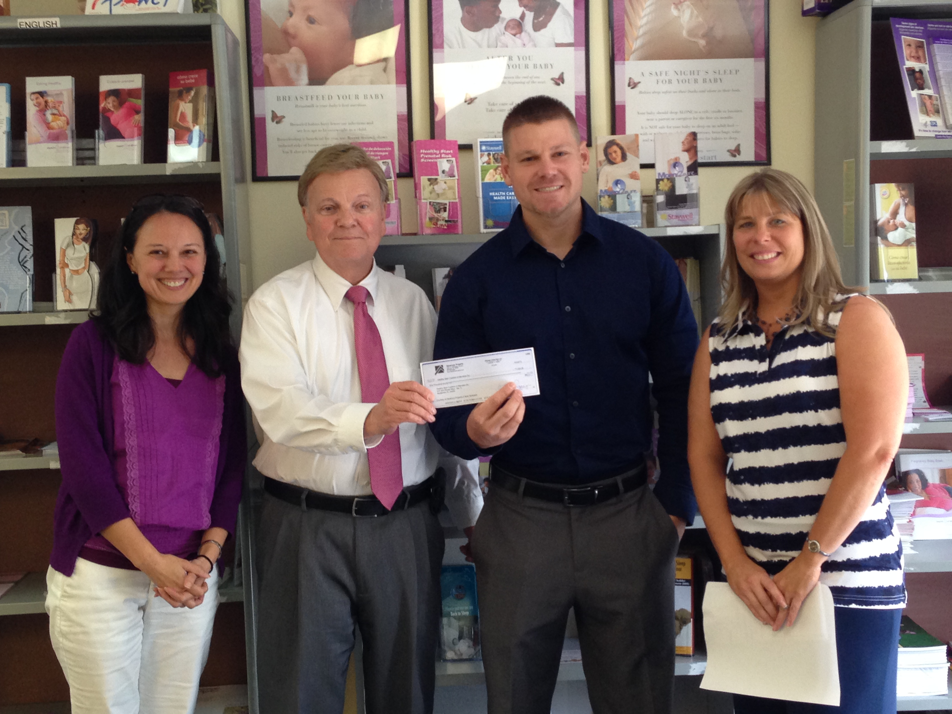 Manatee charity recevies donation From Sarasota Real Estate Brokerage