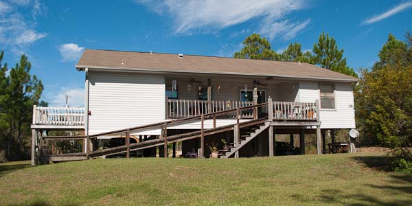 Elevated waterfront home for sale in Milton, FL